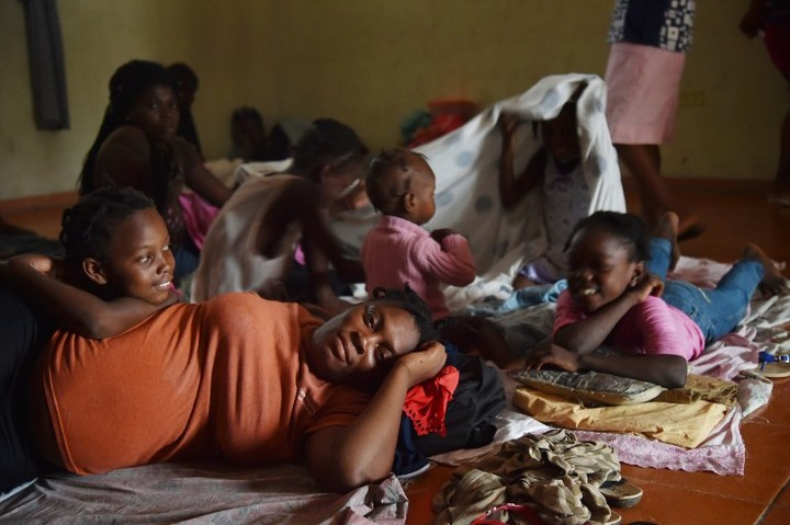 Luisiana and her family shelter at a school after their home was damaged in Port-au-Prince.