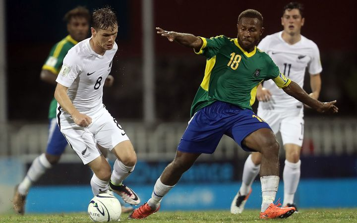 Solomon Islands captain Henry Fa'arodo challenges for the ball against New Zealand at the OFC Nations Cup.