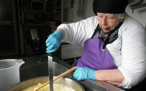 Biddy making cheese at her Eketahuna factory.