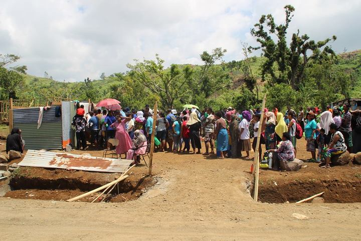 People queue to take bathe in the Natadradave stream's water said to hold healing properties.