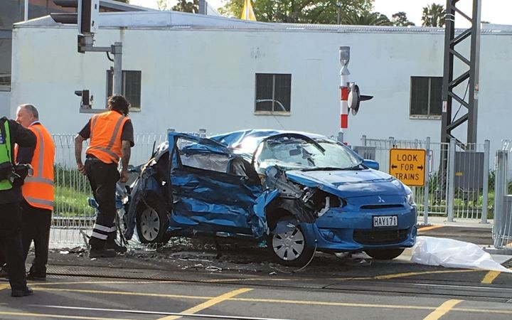 The woman's car was extensively damaged after colliding with the train.