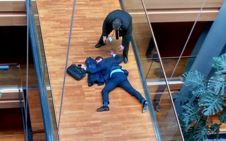 UK Independence Party MEP, Steven Woolfe, lying face-down on a walk-way inside the European Parliament building in Strasbourg in eastern France. October 6 2016