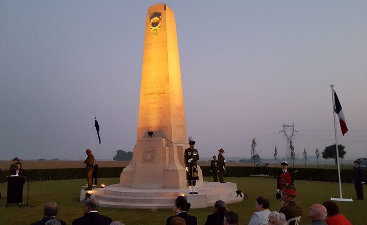 Obilisk war memorial at daybreak with guards and wreaths at Somme 100 year commemorations
