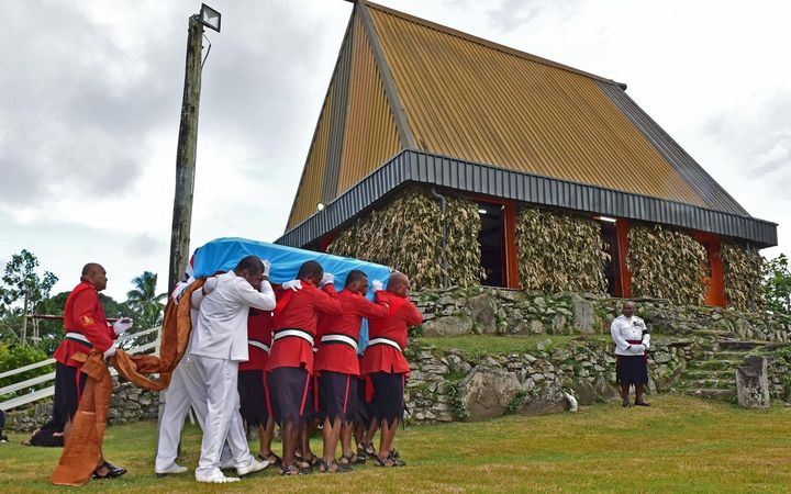 Soldiers carry the casket of Fiji's former vice president, Ratu Joni Madraiwiwi, to a church on the chiefly island of Bau on Thursday. He was buried on Friday.