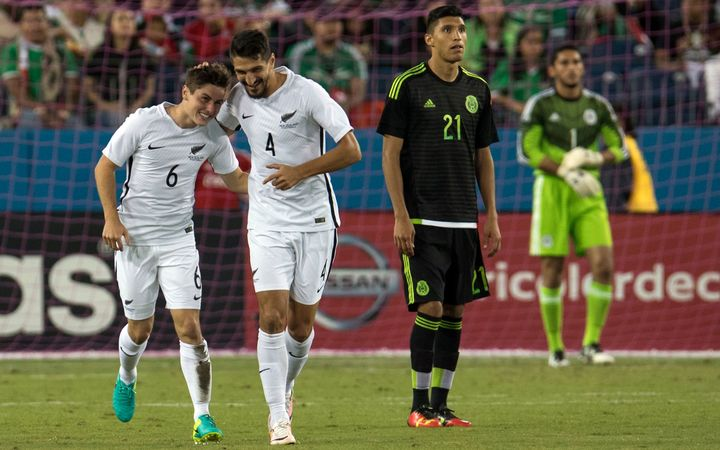 Marco Rojas celebrates his goal with team mate Themi Tzimopoulos.