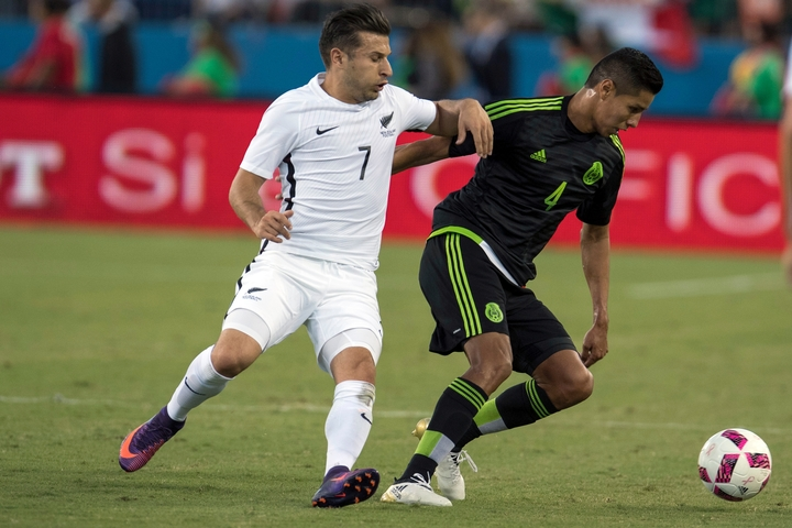 Kosta Barbarouses challenges for the ball against Mexico