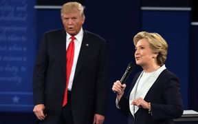 Donald Trump stands behind Hillary Clinton at the second presidential debate.