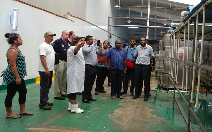 Business and government fisheries department representatives attending a tuna canning training in Majuro received a tour of the Pan Pacific Foods tuna loining plant.