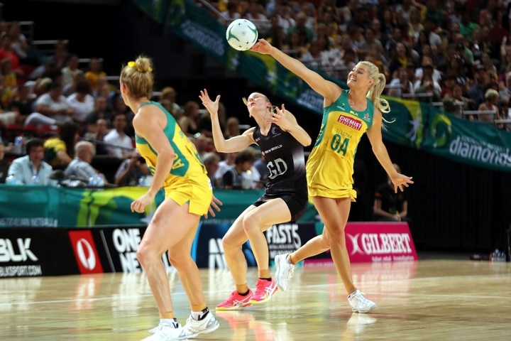 New Zealand's  Katrina Grant and Australia's Gretel Tipett contest the ball in 2016 Constellation Cup test