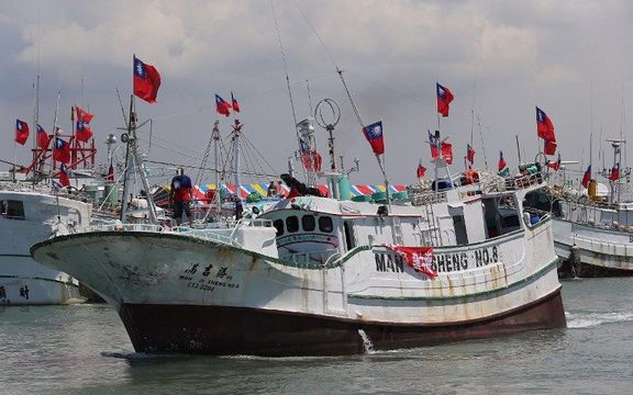 Taiwanese fishing boats are seen departing to Taiping island, part of the disputed Spratly Islands chain in the South China Sea.