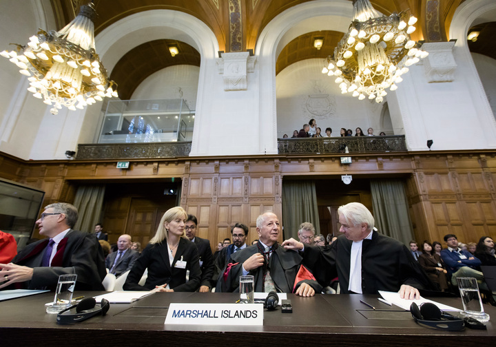 The Marshall Islands' delegation including lawyer Laurie B. Ashton (L), Luigi Condorelli (C) from the University of Florence and Phon van den Biesen (R), lawyer of the Marshall Islands' delegation) sit at the International Court of Justices (ICJ) in the Hague, on October 5, 2016.