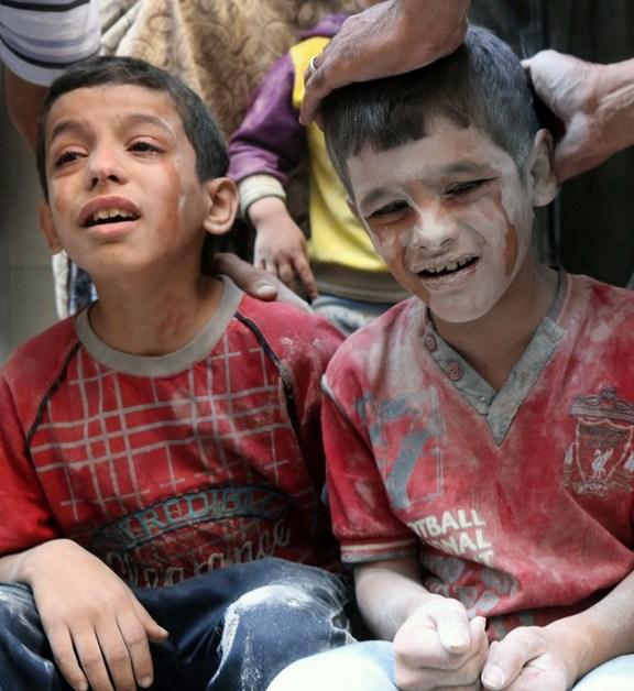 Syrian boys cry following Russian air strikes on the rebel-held Fardous neighbourhood of the northern embattled Syrian city of Aleppo.