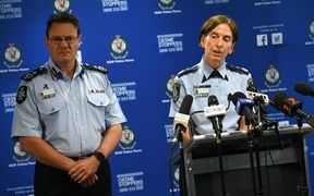 New South Wales Police Commissioner Catherine Burn (R) and Australian Federal Police Deputy Commissioner Michael Phelan address the media after two 16-year-old boys were charged with terror-related offences in Sydney.