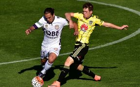 Phoenix midfielder Michael McGlinchey in action against Perth Glory.