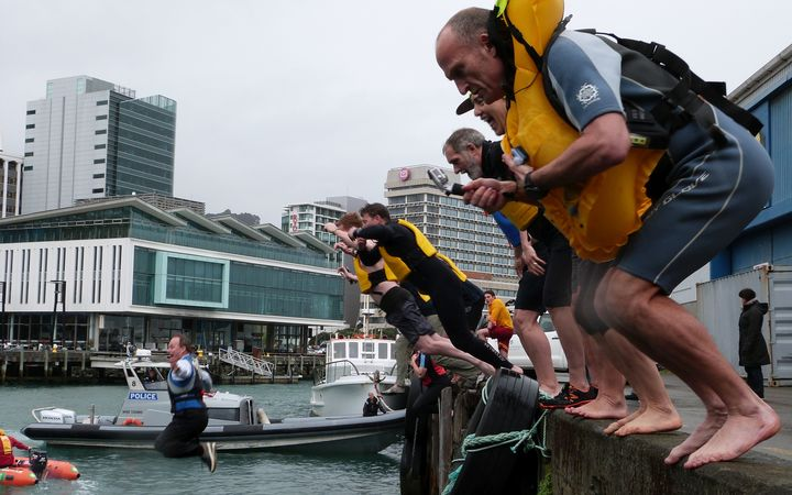 Volunteers take the dive into Wellington harbour on a chill spring morning to boost water safety awareness.