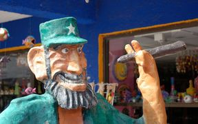 A statue of Fidel Castro holding a cigar outside a Cuban cigar store. Bringing cigars and rum from Cuba to the United States is now allowed.