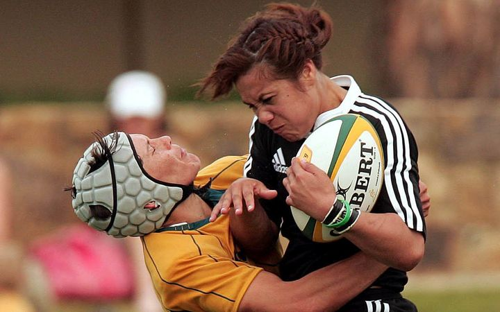 Black Fern Huriana Manuel is tackled by Wallaroo Tui Ormsby, 2008.