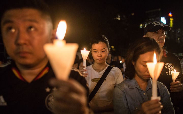 People hold a vigil in Hong Kong on June 4 to mark the 27th anniversary of the bloody Tiananmen Square crackdown.