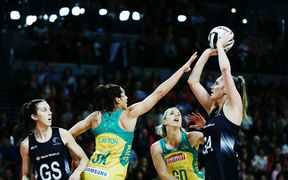 Te Paea Selby-Rickit shoots over Clare McMeniman and Sharni Layton during the Constellation Cup netball match between the New Zealand Silver Ferns and the Australian Diamonds.