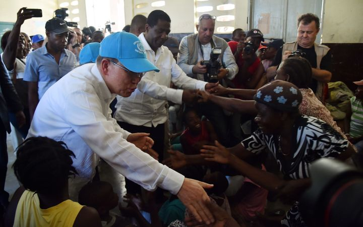UN secretary general Ban Ki-moon visit a shelter in the Lycee Phillipe Guerrier in the city of Les Cayes in the wake of Hurricane Matthew.