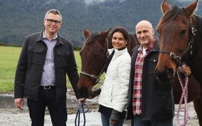 Ngāi Tahu Tourism chief executive Quinton Hall with Dart Stables' current owner Peter Davies and his wife Jenny Davies.