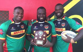 Brothers and Vanuatu teammates Ben Lui (left), Tonny Lui (middle) and Danford Lui (right) with the Vanuatu and Solomon Islands Trophy.