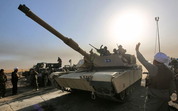 Iraqi forces deploy in the area of al-Shourah, some 45 kms south of Mosul, as they advance towards the city to retake it from the Islamic State.
