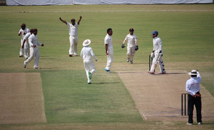 PNG celebrate another Namibian wicket.
