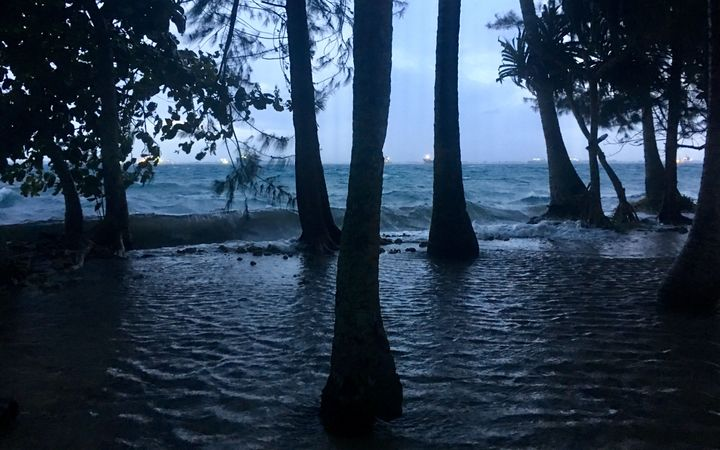 High tide driven by storm waves washes into Ejit Island in Majuro Atoll, flooding a significant part of the small island that is home to displaced Bikini Islanders.