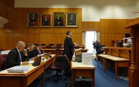 Francis Cooke QC (centre) speaks for disgruntled Southern Response customers at the High court in Christchurch.