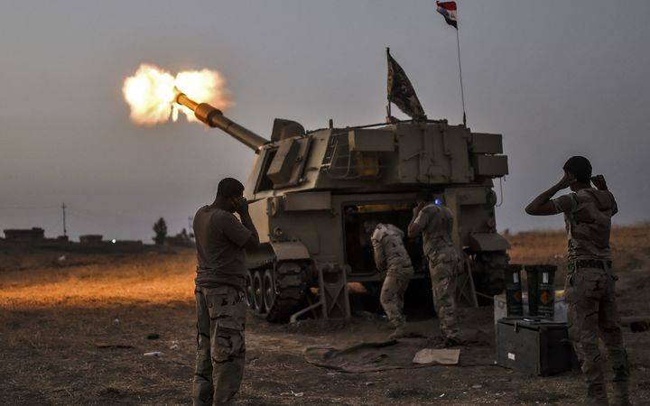 Iraqi forces some 35km from Mosul fire towards the village of Al-Muftuya.