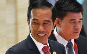 Indonesia's President Joko Widodo (L) arrives at the Association of Southeast Asian Nations (ASEAN) Summit in Vientiane on September 7, 2016.