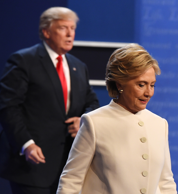 Donald Trump and Hillary Clinton exit the stage after their third and final presidential debate.