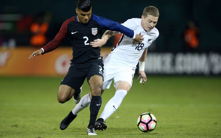 All White Kip Colvey battles for the ball with USA's DeAndre Yedlin during the two sides 1-all draw.