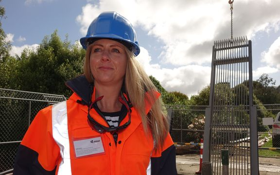Dunedin City Council infrastructure and networks general manager Ruth Stokes helps install the new pump screen.