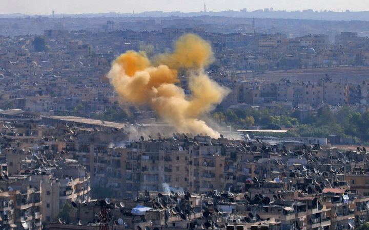 Smoke from reported opposition fire rises in a designated humanitarian corridor in eastern Aleppo.