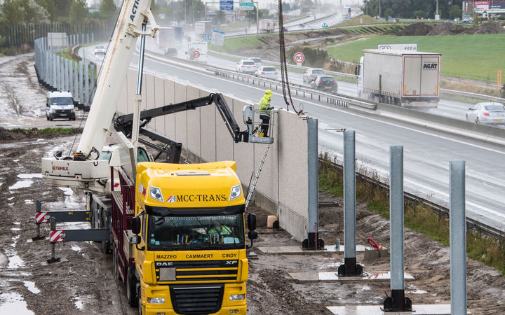 The 4-metre high 'Great Wall of Calais' being built as the French authorities prepare to dismantle a camp for refugees and migrants trying to reach the UK.