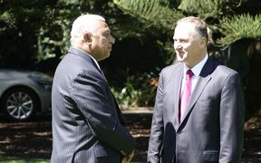 Fiji Prime Minister Frank Bainimarama and New Zealand Prime Minister John Key chat at Government House