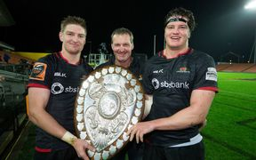 Canterbury's Jordie Barrett and Scott Barrett with their father Kevin holding the Ranfurly Shield.
