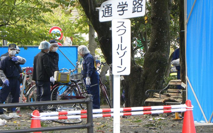 Policemen investigate an explosion site at a park in Utsunomiya, some 100 kilometres (60 miles) north of Tokyo on October 23, 2016