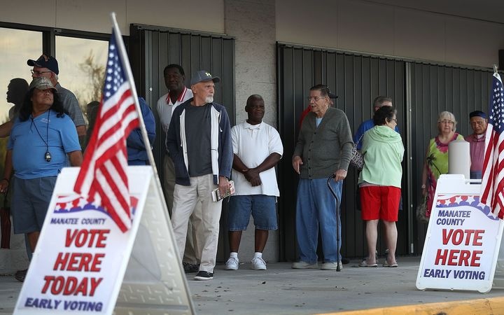 Voters line up to vote early at the Supervisor of Elections office on October 24, 2016 in Bradenton, Florida.