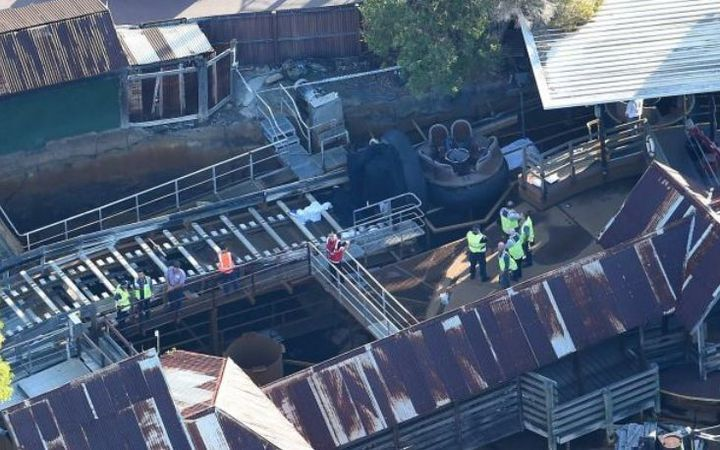 Police removing the raft from the accident site at Dreamworld.