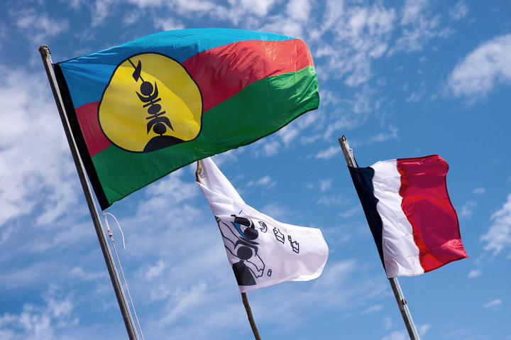 Kanak and French flags on Ouvea island.