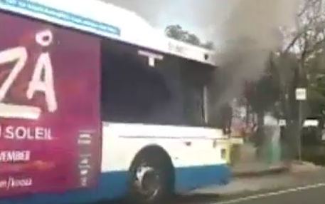 The bus was engulfed in smoke after the driver was set on fire.