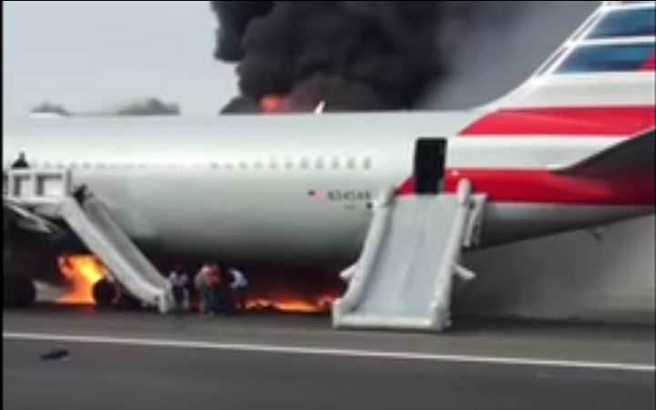 American jet blows tire, catches fire at O'Hare; 8 injured