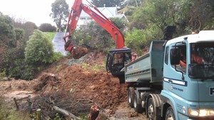 Dunedin City Council workers work on clearing the Blanket Bay Road slip.
