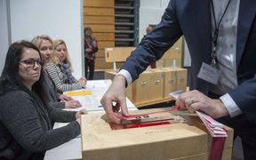 A member of the polling commission prepares the ballots for counting at a polling station in Kopavogur on October 29