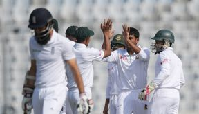 Bangladesh's Mehedi Hasan receives high fives from teammates after taking the wicket of England's Moeen Ali