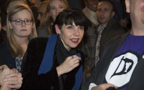 Pirate Party co-founder Birgitta Jonsdottir, centre, reacts as the election results are announced.