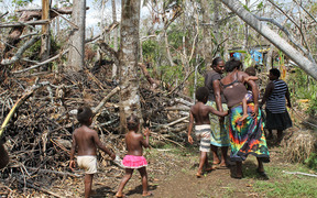 Shaline Nimal walks through what is left of the village of Rangorango on Efate island, Vanuatu.